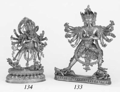 A Tibetan gilt bronze group