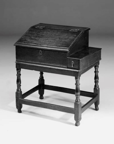 An oak desk on stand, English,