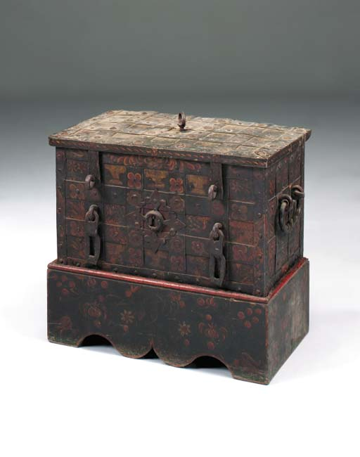 A painted iron strongbox on st