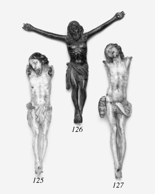 A carved ivory Corpus Christi,
