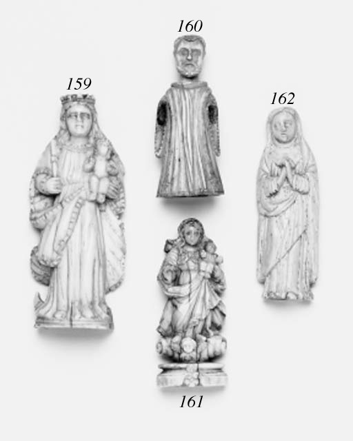 A carved ivory figure of St.Fr