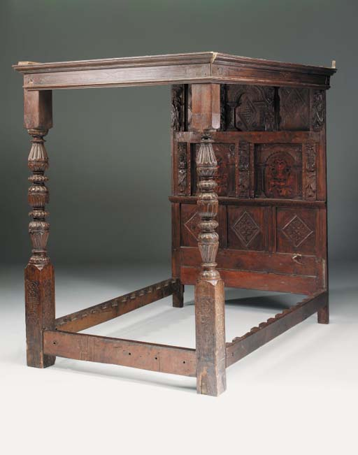 An oak and inlaid tester bedst