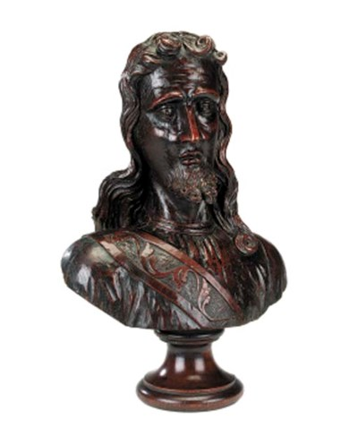A carved oak library bust of a