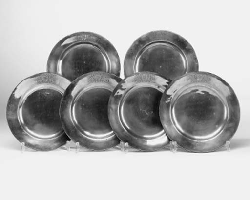 A set of six pewter plates, mi