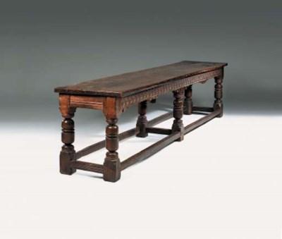An oak six-leg refectory table