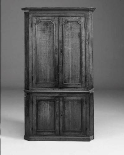An oak standing corner cupboar