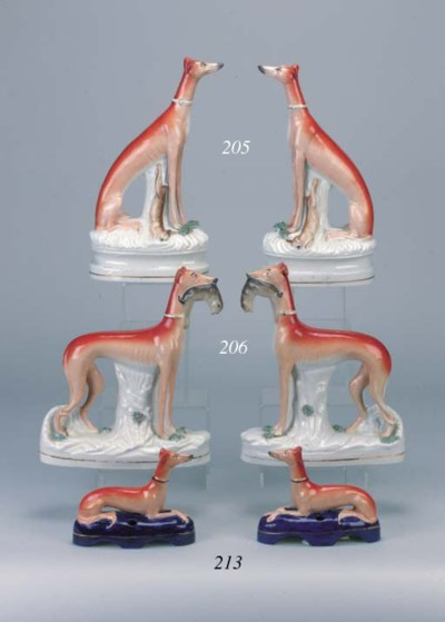 A pair of greyhound penholders