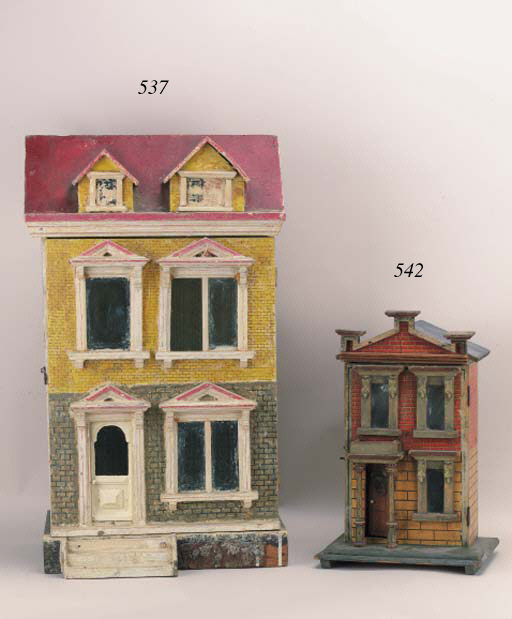 A blue roofed dolls' house