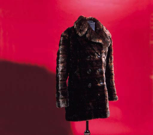 A sumptuous fake fur coat, the buttons stamped GUCCI, the coat similarly labelled