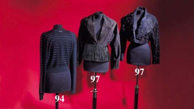 A short jacket of black suede,