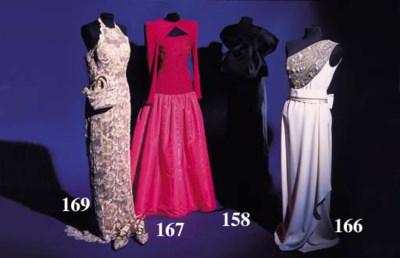 A halter neck evening dress, o