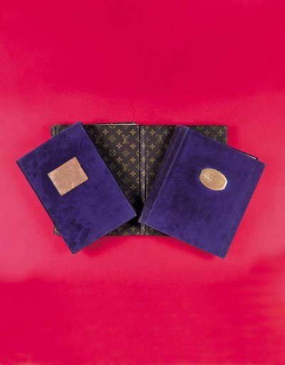 A pair of photo albums bound i