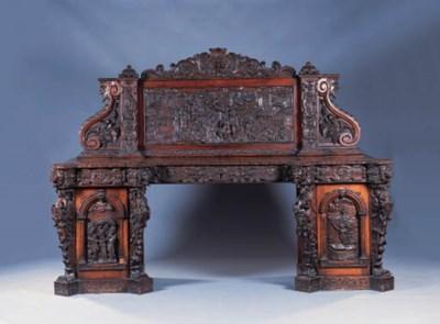 A heavily carved oak sideboard