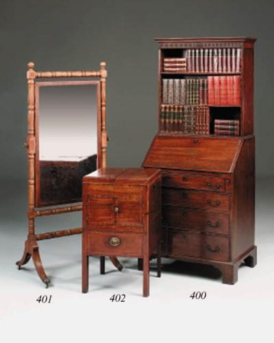 A small mahogany bureau bookca
