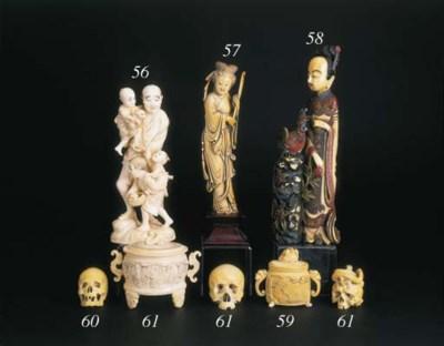 An ivory okimono of a standing