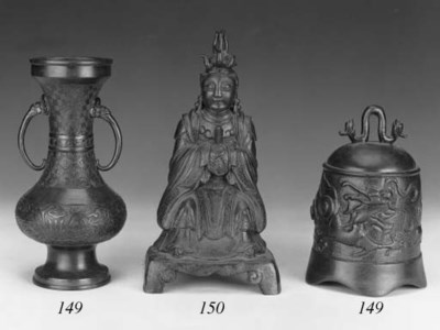A Ming bronze seated deity
