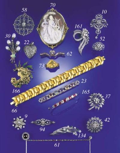 A diamond and cabochon garnet
