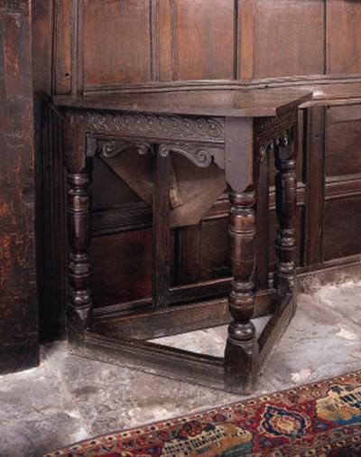 An oak triangular table, Engli