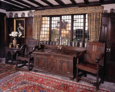 An oak panelled chest, Glouces