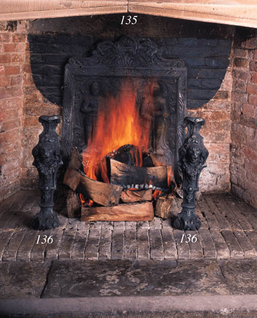A pair of cast iron andirons,