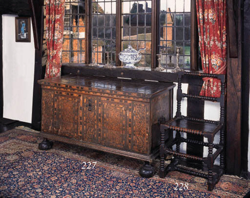 An oak and inlaid chest, Anglo