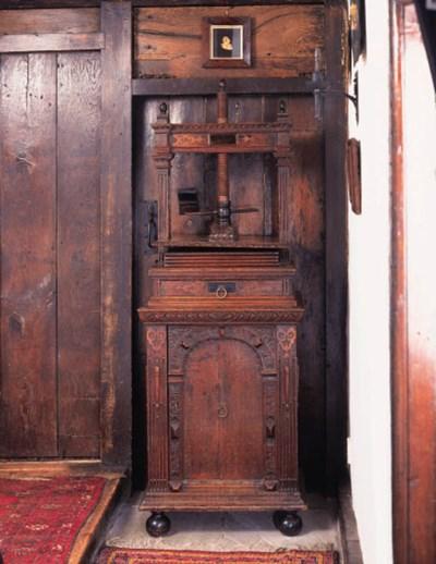 An oak book press on cupboard,