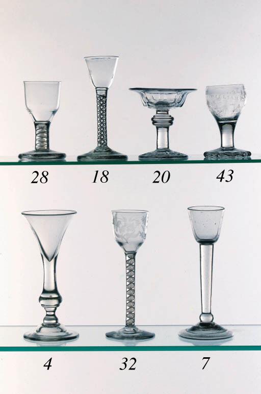 A plain-stemmed cordial glass