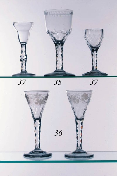A pair of engraved facet-stemm