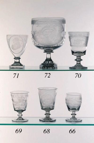 An engraved barrel-shaped rumm