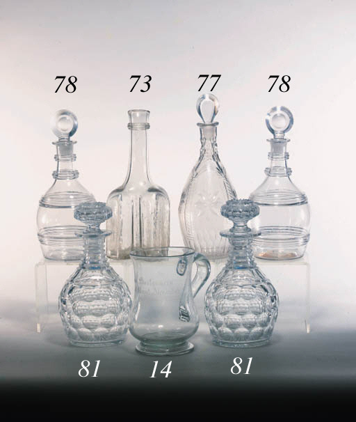 A cut club-shaped decanter and