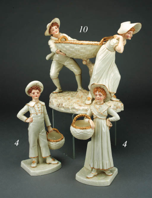 A pair of Royal Worcester 'Hadley' figures of a boy and girl