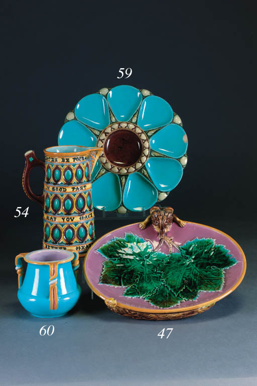 A Minton majolica triple-handled turquoise-ground squat baluster vase