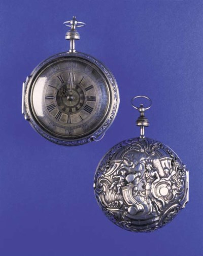 A SILVER REPOUSSE STRIKING AND
