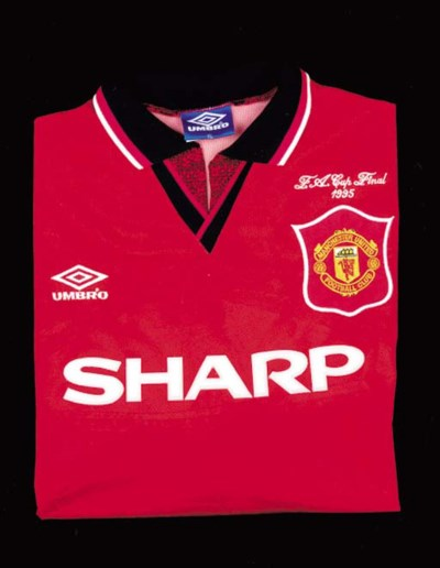 A red Manchester United shirt,