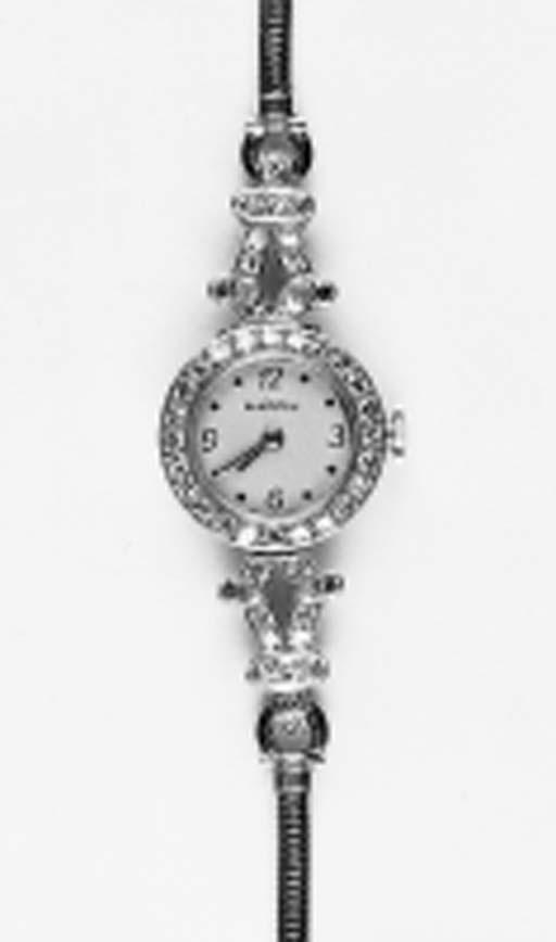 A lady's diamond wristwatch by