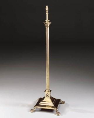 A polished brass standard lamp