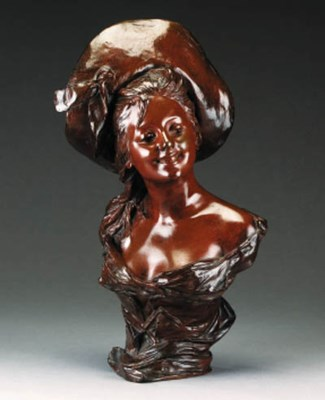A bronze bust of a lady, late