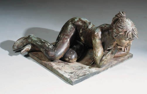A bronze model of a reclining