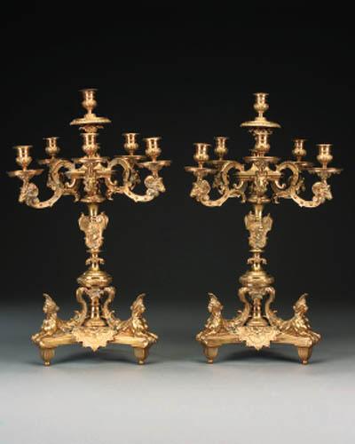 A pair of Regence style gilt b