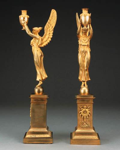 A pair of Empire gilt bronze f