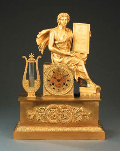 An Empire gilt bronze mantel c