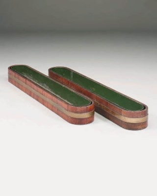 A pair of teak and brass bound