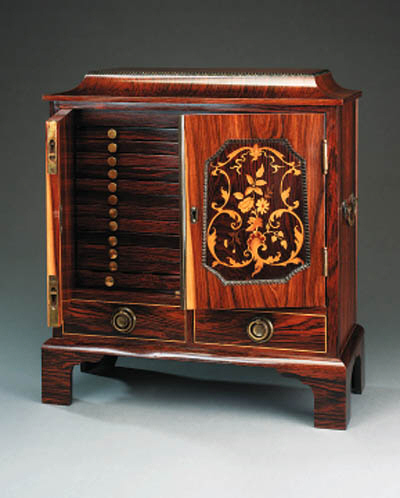 A French rosewood coin cabinet