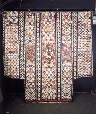 A large shaped patchwork cover