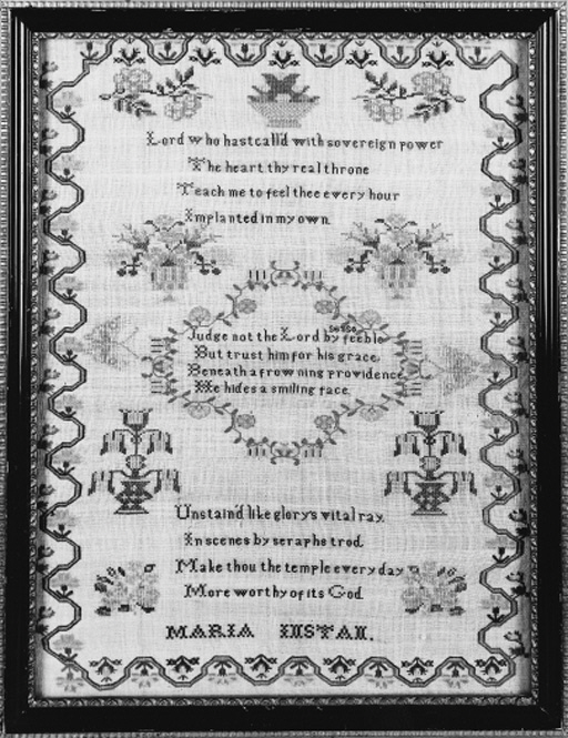 A sampler by Maria Instan, worked mainly in cross stitch and Algerian eye with three pious verses, an undulating floral border and spot motifs of flower-filled vases and butterflies, framed and glazed--15 x 14.25in. (38 x 36.25cm.)