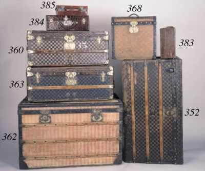 A Louis Vuitton trunk covered