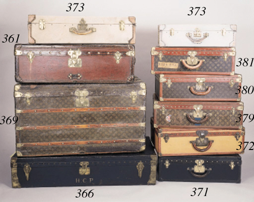A suitcase covered in white canvas, bound in vellum and brass, with leather handle, the clasp and inner ledge stamped HERMES PARIS, the lock numbered A.6, the interior with leather straps--31 1/2 x 17 3/4 x 8in. (78 x 44 x 20cm.); and another, smaller, initialled P.W on the front, canvas white washed, both circa 1930