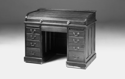 A mahogany rolltop desk, early