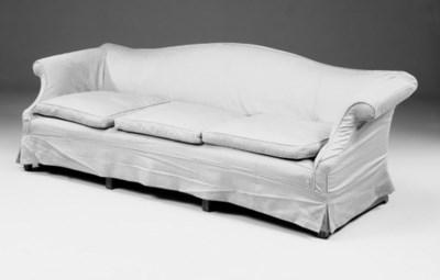 A mahogany and upholstered sof