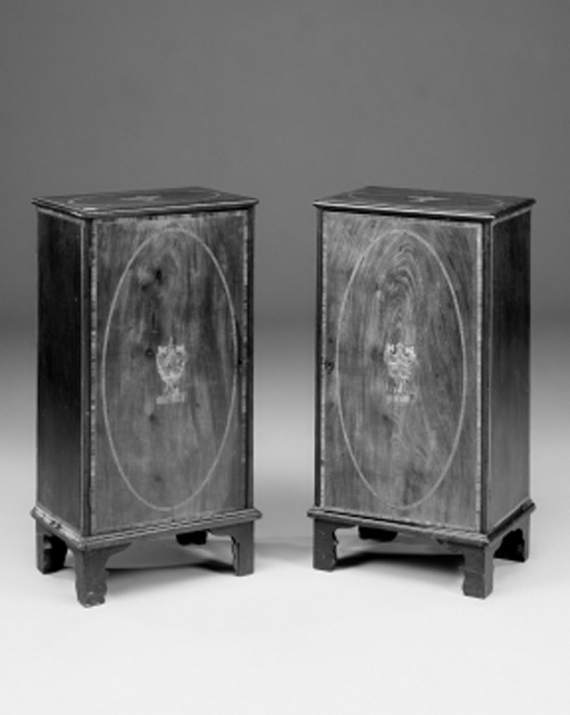 A pair of mahogany, tulipwood-banded and inlaid cabinets, 19th century and later
